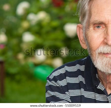 Half face courageous seniors against summer personal plot. - stock photo