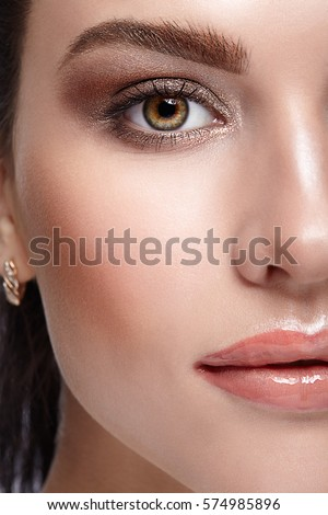 Half face female beauty portrait with day beauty makeup