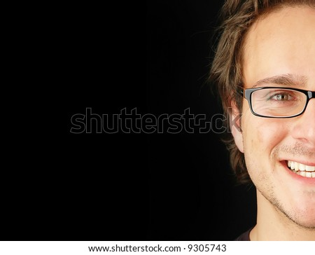half face of a businessman happy and smiling with plenty room for text