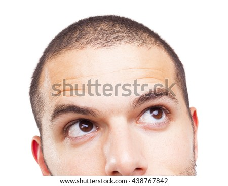Half face of a young man looking up, isolated on white background - stock photo