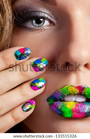 Half face of attractive girl with beautiful multicolor holographic Minx nails and bright colorful make-up