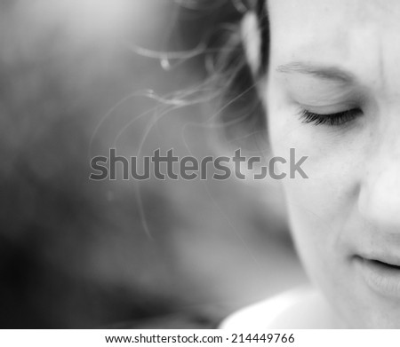 Half face of beautiful natural woman on background of green trees. Very high resolution. - stock photo