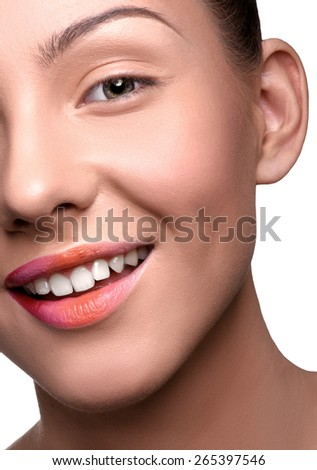 Half face of cheerful, happy young woman with colorful lips makeup looking at the camera. Close up head shot - stock photo