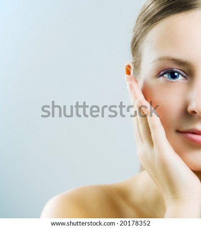 Half face of young woman. - stock photo
