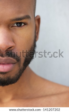Half face portrait of a handsome young african american man shirtless - stock photo