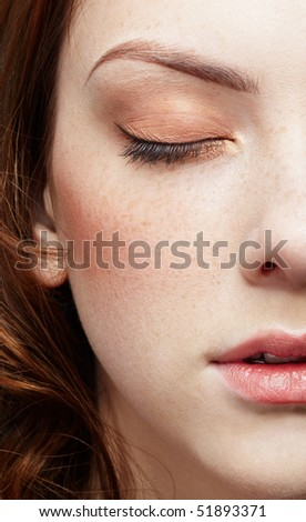half-face portrait of pale freckled girl - stock photo