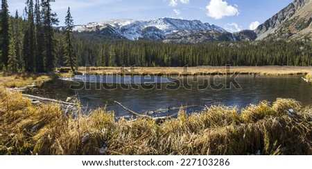 Half frozen ponds created by beavers on the Mohawk Lakes trail near Breckenridge, Colorado in the Rocky Mountains. - stock photo
