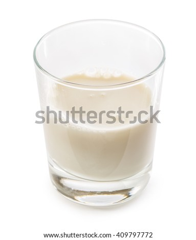 Half full glass of fresh milk closeup - stock photo