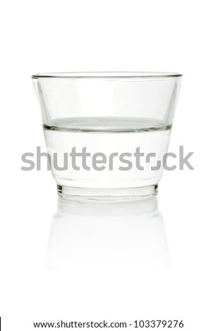 Half full, half empty glass of water - stock photo
