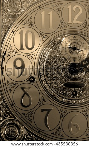 Half Grandfather clock face twelve eleven ten nine eight seven six sepia tone photograph photo numbers time 12 11 10 9 8 7 6 tick tock numbers close up - stock photo