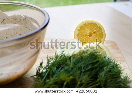 half lemon with dill ingredients - stock photo