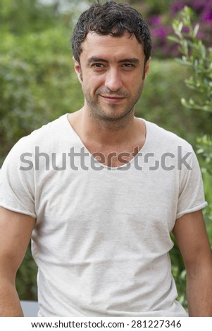 Half-length color portrait of young man about thirty-five years old, looking and smiling to the camera, casual style. - stock photo