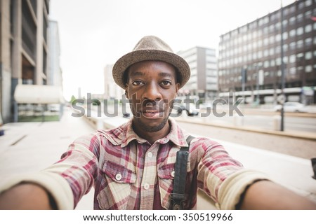 Half length of young handsome afro black man taking a selfie, looking in camera, smiling - vanity, social network concept - stock photo