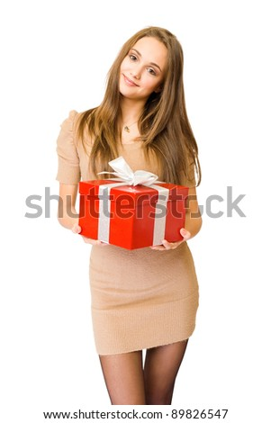 Half length portrait of a beautiful young brunette posing with bright red gift box, isolated on white background - stock photo