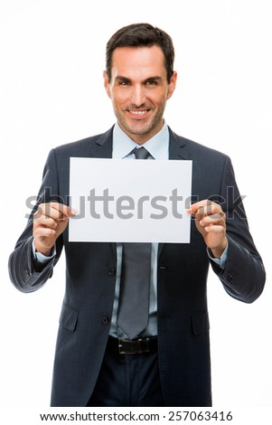 Half length portrait of a smiling businessman holding a blank paper