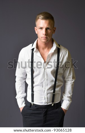 Half length portrait of a young male fashion model.