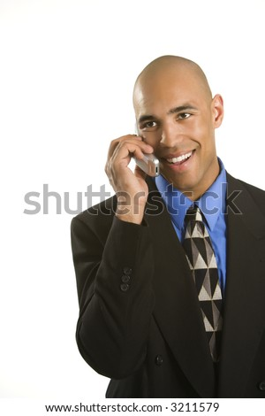 Half length portrait of African American man in suit talking on cellphone. - stock photo