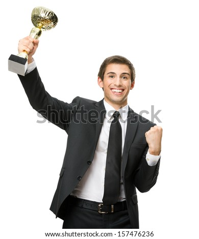 Half-length portrait of businessman handing gold cup up, isolated on white. Concept of leadership and success - stock photo