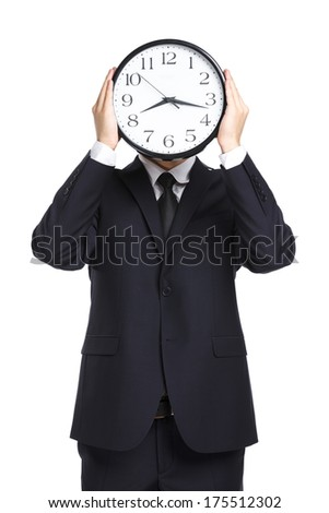 Half-length portrait of businessman holding clock in front of his face, isolated on white