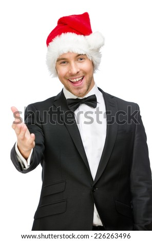 Half-length portrait of businessman wearing Santa Claus cap who handshake gestures, isolated on white. Concept of holidays and Christmas - stock photo
