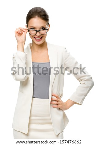 Half-length portrait of businesswoman wearing glasses, isolated on white. Concept of leadership and success - stock photo
