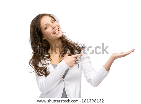 Half-length portrait of female with palm up and pointing hand gesture, isolated on white - stock photo