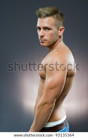Half length portrait of fit young handsome man.
