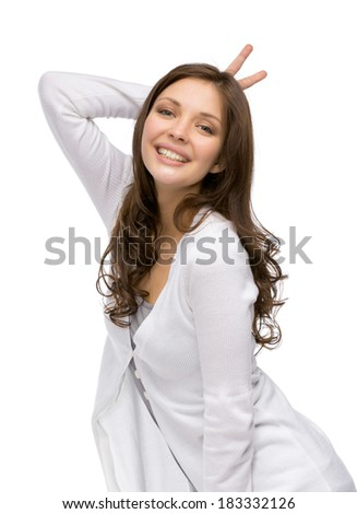 Half-length portrait of girl horns gesturing, isolated on white - stock photo