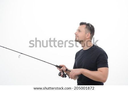 Half-length portrait of handsome fisherman holding a spinner in his hands and thinking that he caught something. Isolated on white background - stock photo