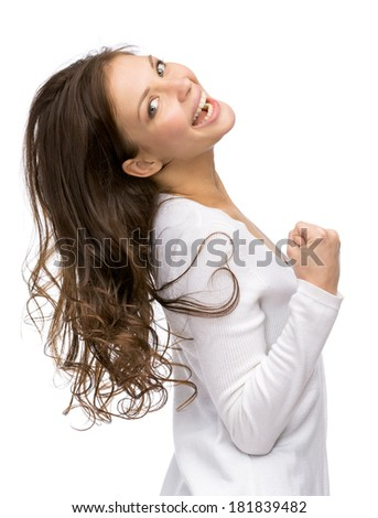 Half-length portrait of happy girl fists gesturing, isolated on white. Concept of success and victory - stock photo