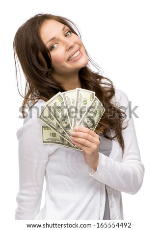Half-length portrait of happy woman handing cash, isolated on white. Concept of wealth and income - stock photo