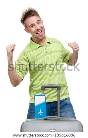 Half-length portrait of man fists gesturing with travel suitcase and ticket, isolated on white - stock photo