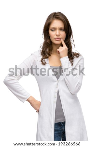 Half-length portrait of pensive woman touching her face, isolated on white - stock photo