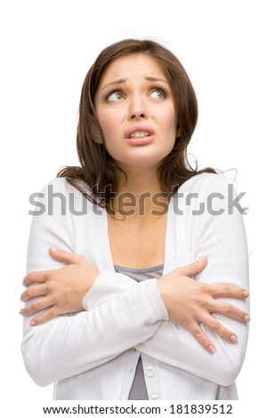 Half-length portrait of trembling girl, isolated on white. Concept of cold and chill - stock photo