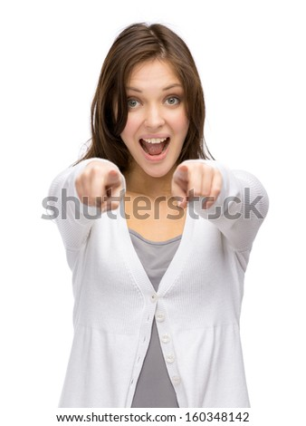Half-length portrait of woman pointing with hand, isolated on white - stock photo