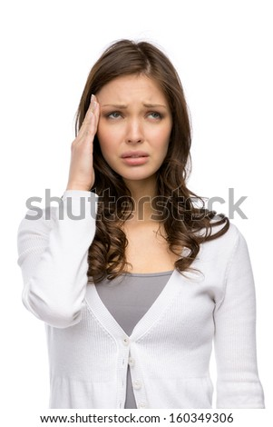 Half-length portrait of woman touching her head, isolated on white. Concept of headache and high temperature - stock photo