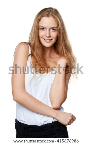 Half length portrait of young beautiful blond candid woman cheering smiling at camera, over white background - stock photo