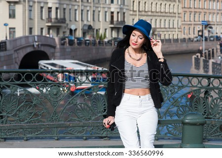Half length portrait of young female tourist enjoying good day after active walking in the fresh air in autumn day, brunette woman dressed in stylish clothes relaxing after strolling in urban setting - stock photo
