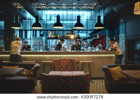 Halflighted Hall Loft Style Mexican Restaurant Stock Photo