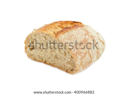 Half loaf of unleavened bread made from wheat and rye meal with bran on a light background - stock photo