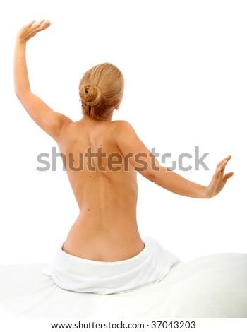 Half-naked woman waking up isolated over white - stock photo