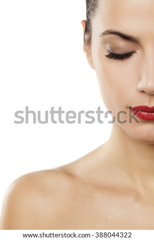 half of female portrait with closed eyes on a white background