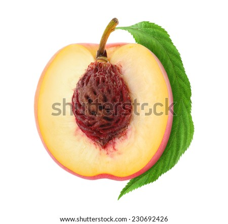 Half of fresh peach with nut and leaf isolated on white background, with clipping path - stock photo