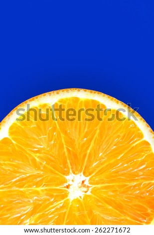 Half of juicy fresh orange isolated on blue background - stock photo