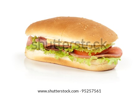 half of long baguette sandwich with lettuce, tomatoes, and ham