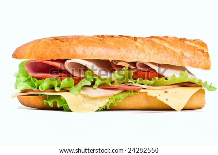 half of long baguette sandwich with lettuce, tomatoes, ham, turkey breast and cheese - stock photo