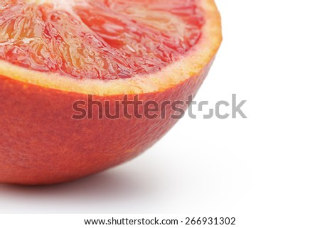 half of ripe blood red orange white background, macro - stock photo