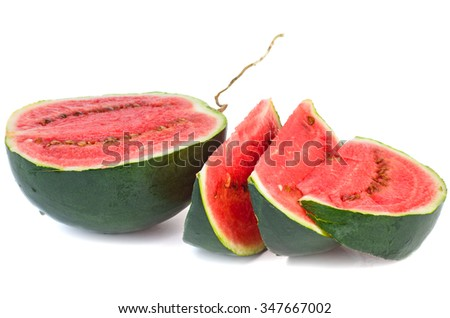 Half of watermelon and slices isolated on white background - stock photo