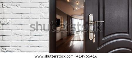 Half Opened Door To A Living Room Handle Lock Lounge