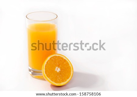 half  orange, and a glass of fresh  juice isolated